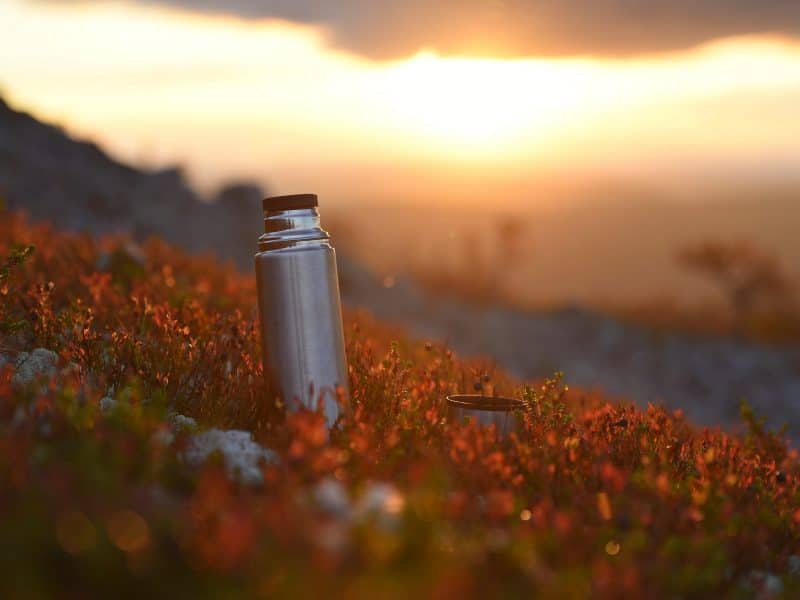 Thermos in sunset on the mountain in Vemdalen