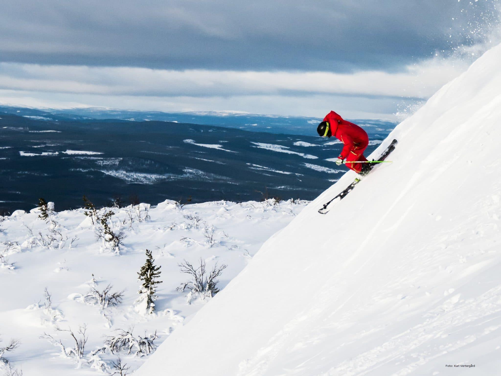 Skier in steep hill